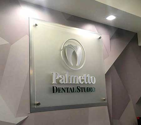 palmetto dental studio front desk sign