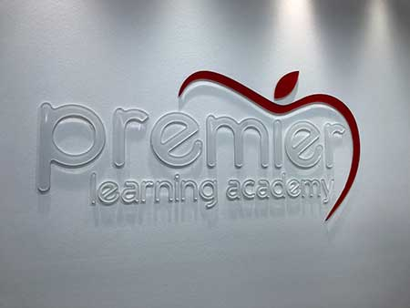 premier learning academy front desk sign